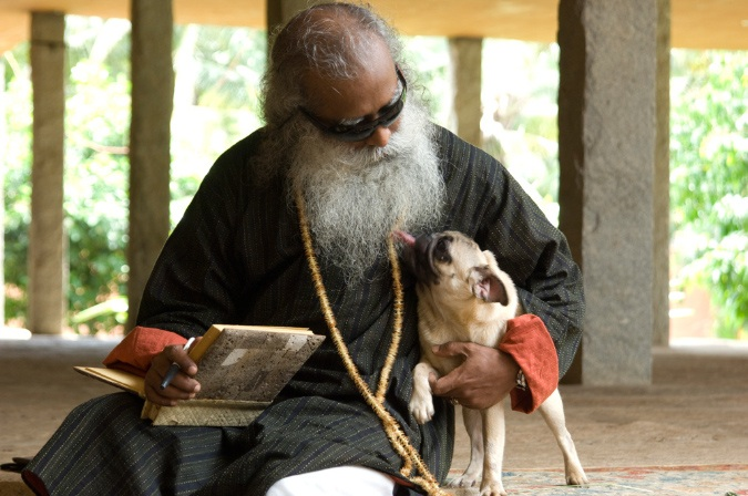 sadhguru-writing-with-leela-at-his-side
